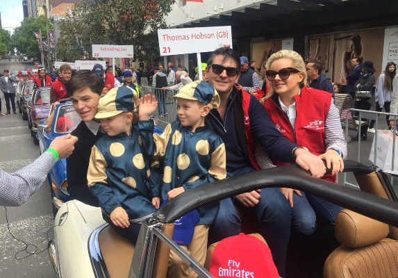 Trainer Hugo Palmer and his family (Wall Of Fire), and jockey Craig Williams enjoying the Melbourne Cup Street Parade.