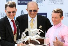 Aidan O'Brien and Seamie Heffernan with Investec Derby trophy.