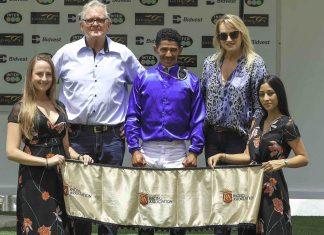 Piet Steyn (left), Grant Behr and Karen Norman in the winner's enclosure.