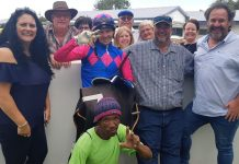 Zietsman Oosthuizen (inside right), with jockey Raymond Danielson, patrons and friends.